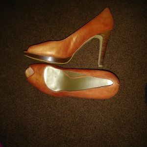 Worn burnt orange heels. Good shape on heel.